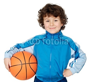 adorable child playing the basketball